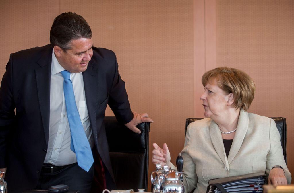 Bundeskanzlerin Angela Merkel (CDU) und Wirtschaftsminister Sigmar Gabriel (SPD) wollen mit den Beschlüssen der Koalition Handlungsfähigkeit demonstrieren. Foto: dpa