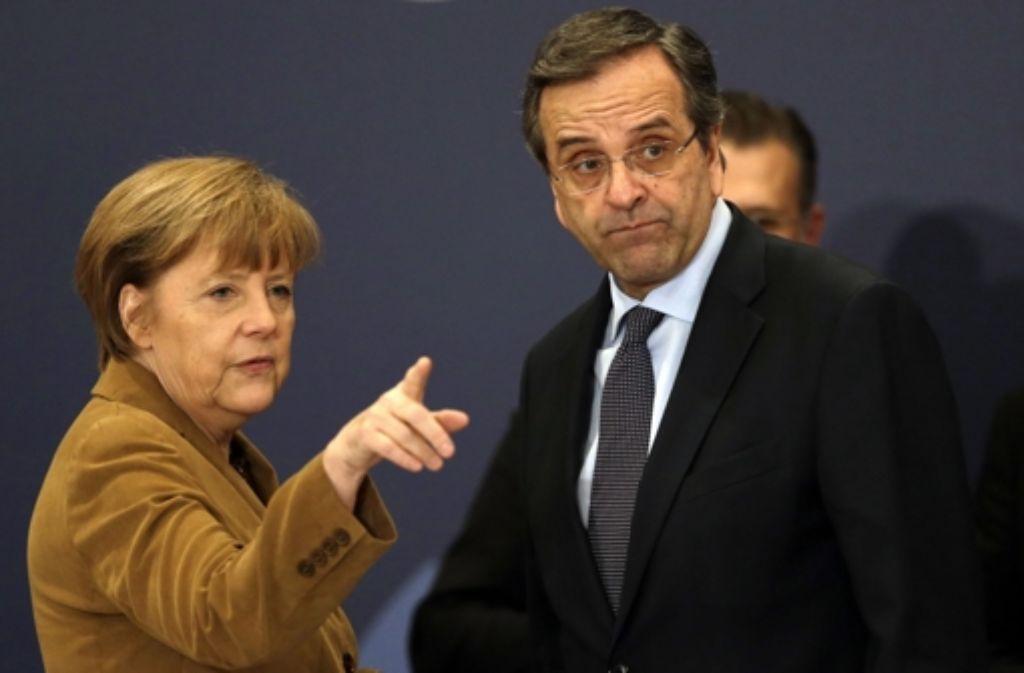 Welchen Weg soll Griechenland gehen? Angela Merkel und Premier Antonis Samaras beim Griechenland-Besuch der deutschen Kanzlerin. Foto: AP