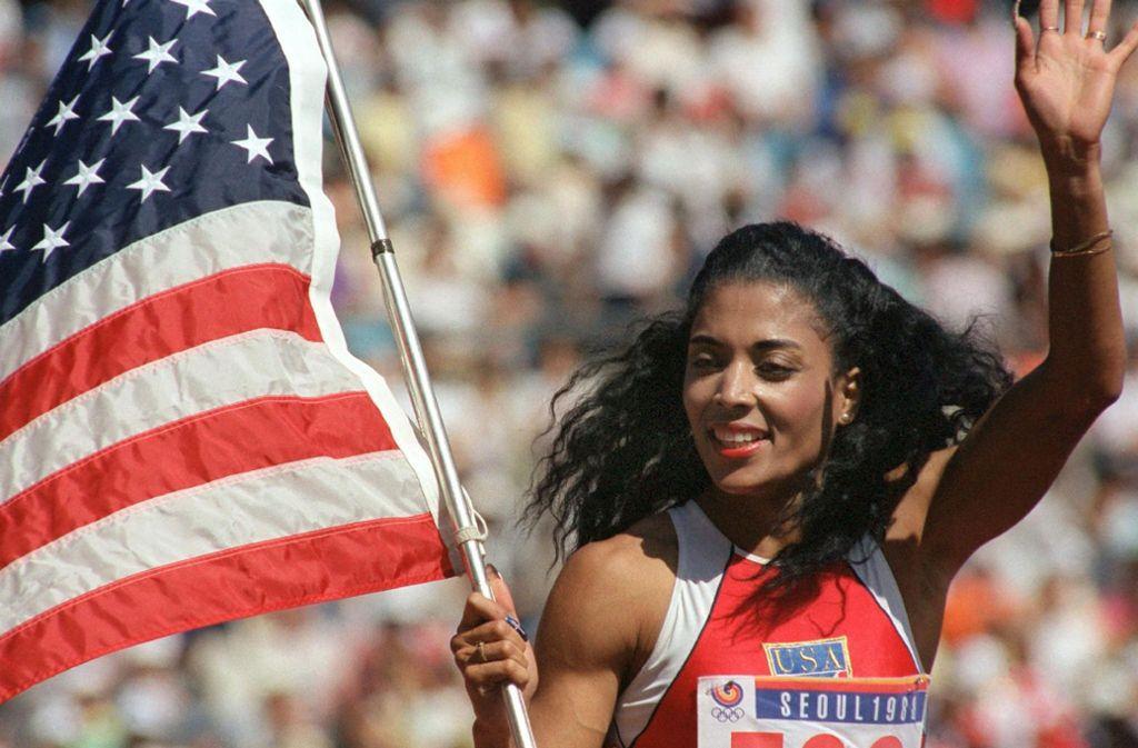 Ein Mahnmal der Leichtathletik: Florence Griffith-Joyner (Mitte). Sie starb mit 39 Jahren. Foto: dpa