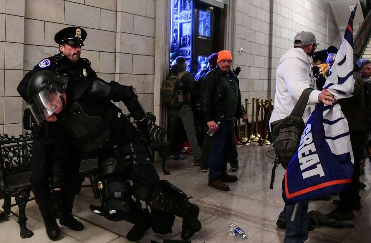 Trump-Anhänger stürmen das Kapitol in Washington. Foto: dpa/Miguel Juarez Lugo