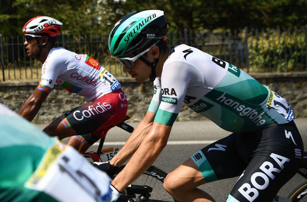 Auch ohne einen Top-3-Rang in Paris sorgt Bora-hansgrohe-Profi Buchmann für die beste deutsche Tour-Platzierung seit 2006. Foto: AFP