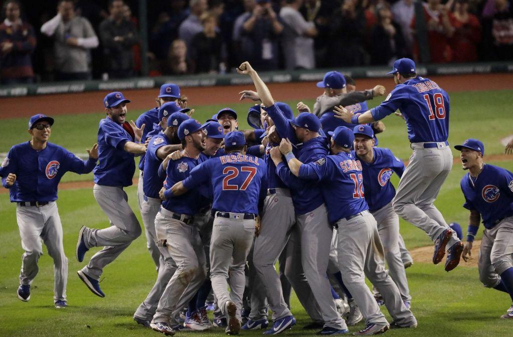 Die Chicago Cubs feiern ihren Meistertitel nach dramatischem Spiel aufgelassen. Foto: AP