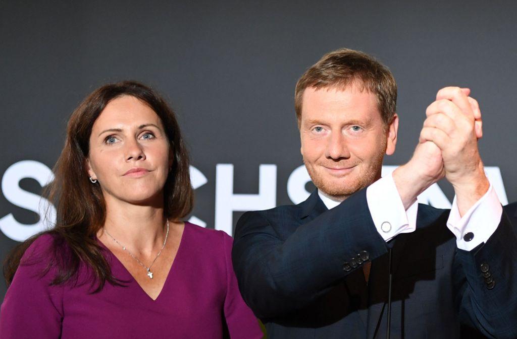 Michael Kretschmer und seine Lebensgefährtin Annett Hofmann bei der CDU-Wahlparty der Landtagswahl in Sachsen. Foto: dpa