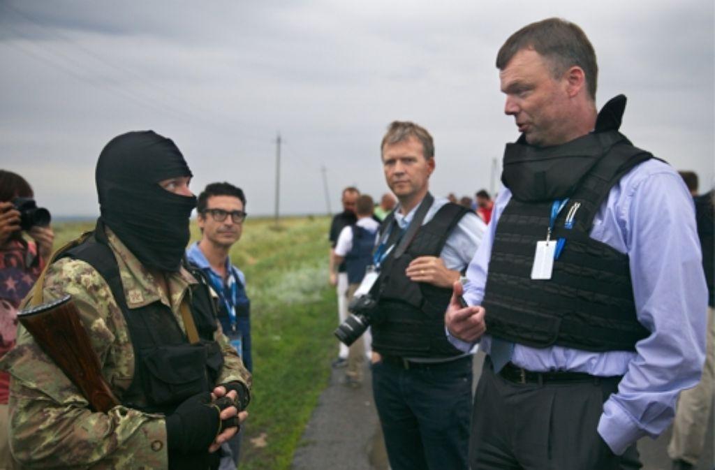 In der Ukraine werden die Aufräumarbeiten weiterhin von pro-russischen Separatisten behindert.  Foto: ITAR-TASS