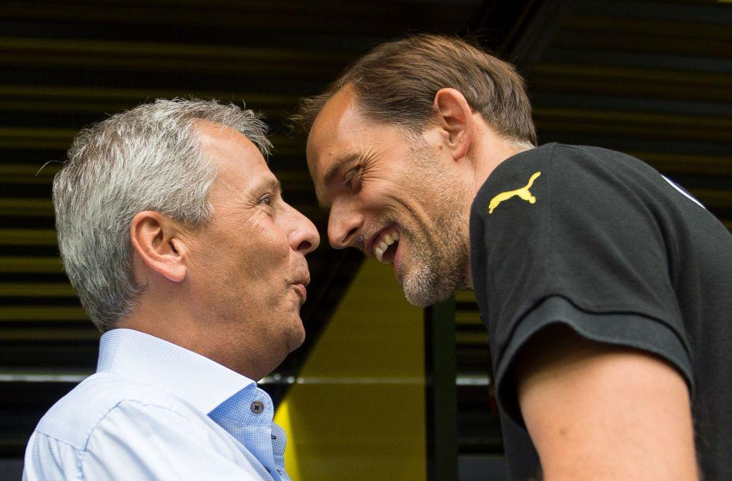 Wird Lucien Favre (links) der Nachfolger von Thomas Tuchel bei Borussia Dortmund? (Archivbild) Foto: dpa