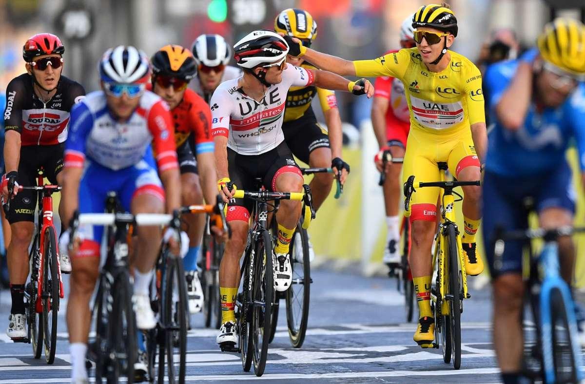 Tadej Pogacar (gelbes Trikot) hat die 107. Tour de France gewonnen. Foto: AFP/STUART FRANKLIN