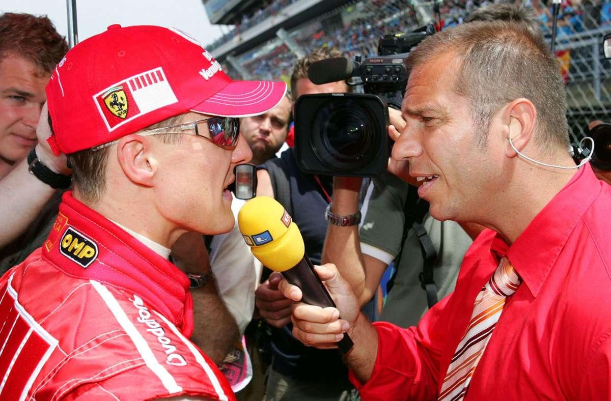 Jahrelang ein Duo: Michael Schumacher und RTL-Reporter Kai Ebel Foto: dpa/Gero Breloer