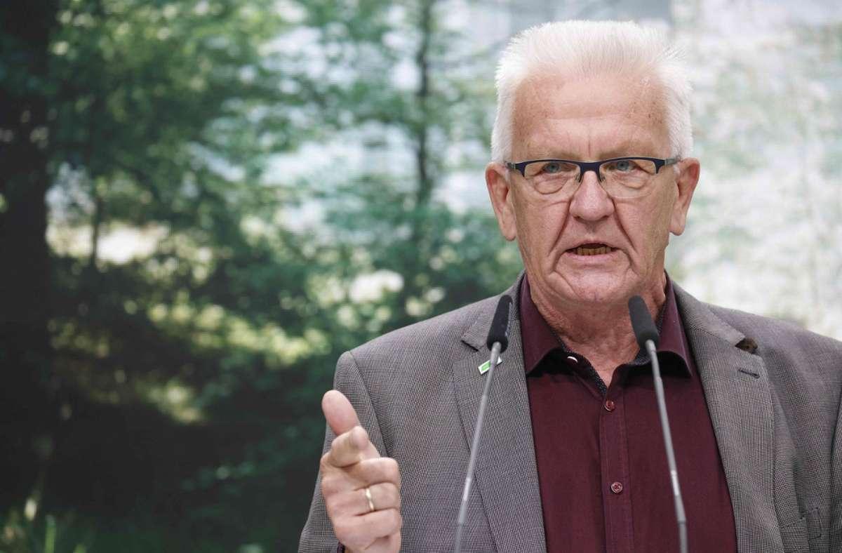 Der grüne Ministerpräsident Winfried Kretschmann sieht den baden-württembergischen Koalitionsvertrag als Blaupause für den Bund. Foto: AFP/ODD ANDERSEN