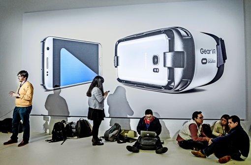 Die mobile Welt  hat auf dem  Mobile World  Congress  viele Facetten –  hier sind Journalisten bei der Arbeit. Foto: Getty