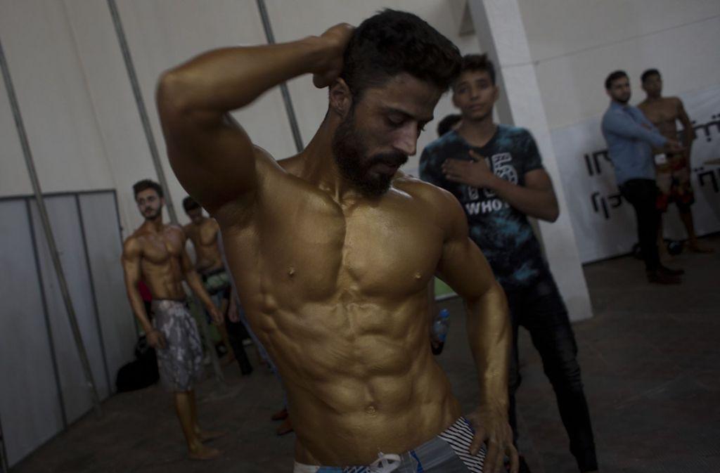Ein Bodybuilder aus Palästina präsentiert seine Muskeln. Foto: AP