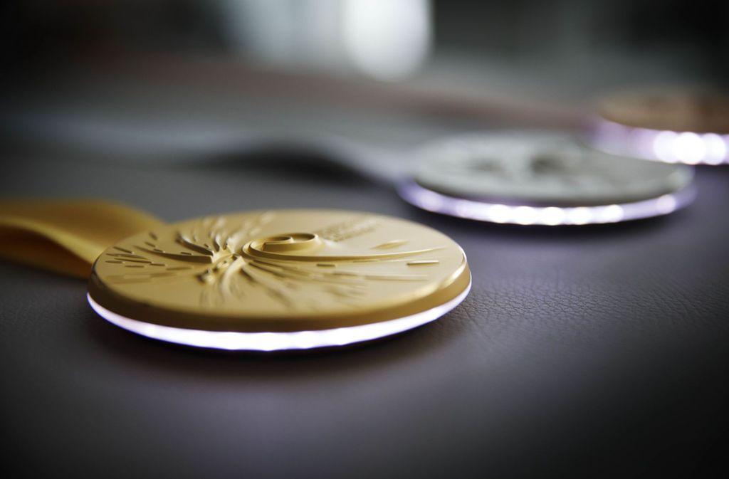 Die Medaillen bei der Turn-WM beleuchten sich selbst. Foto: © C) Gottfried Stoppel
