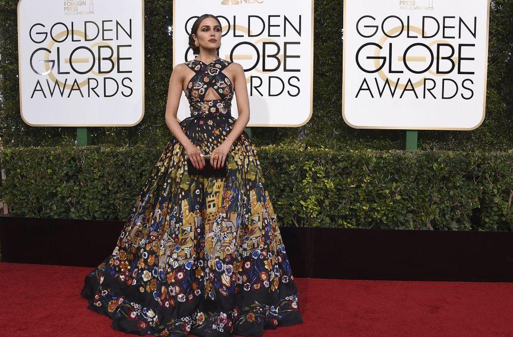 Die amerikanische Schönheitskönigin Olivia Culpo präsentiert sich auf dem Roten Teppich bei der Verleihung der Golden Globes in Los Angeles. Ihre Robe war einer der Hingucker des Abends – konnte man sich doch in ihrem Anblick wie in einem Kunstgemälde verlieren. Foto: AP