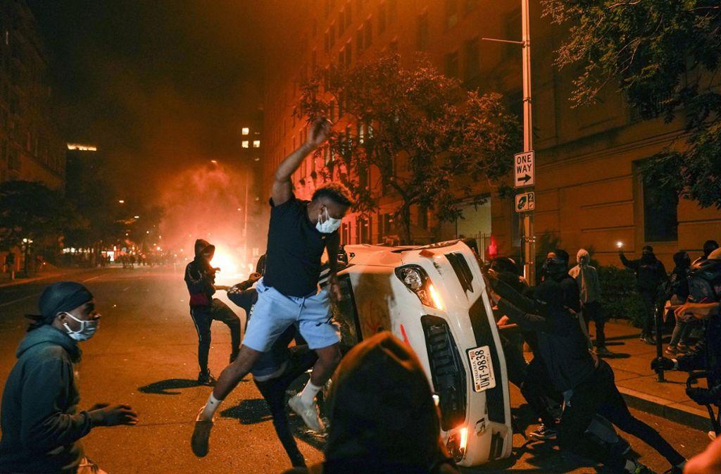 Auch in Washington kam erneut zu massiven Protesten und Gewaltausbrüchen. Foto: dpa/Evan Vucci