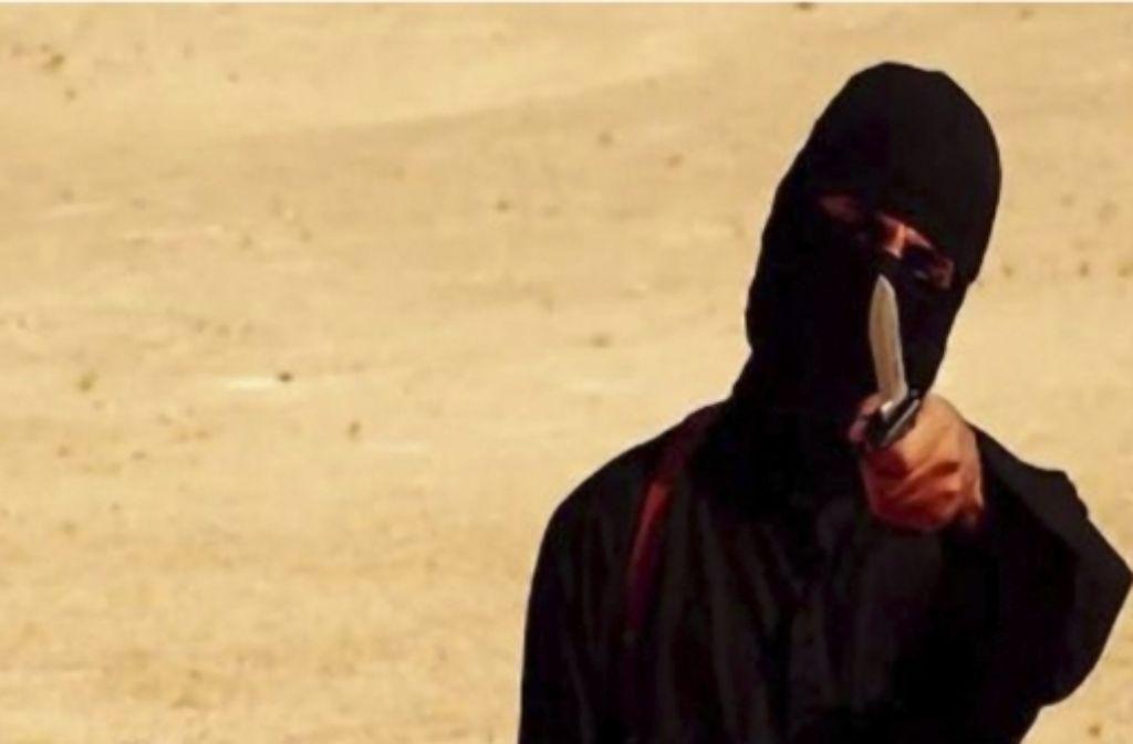 Ein Indonesischer Journalist erinnert an die getöteten Geiseln James Foley und Steven Sotloff. Foto: dpa