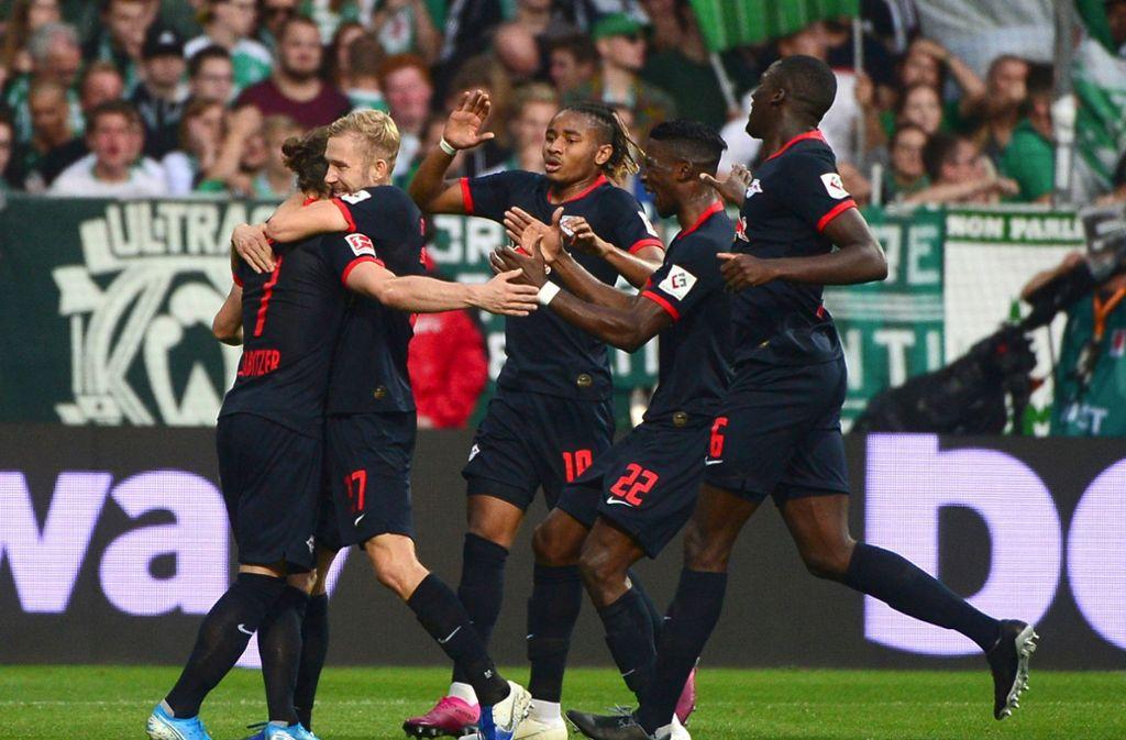 RB Leipzig hat die Tabellenführung verteidigt. Foto: AFP/PATRIK STOLLARZ