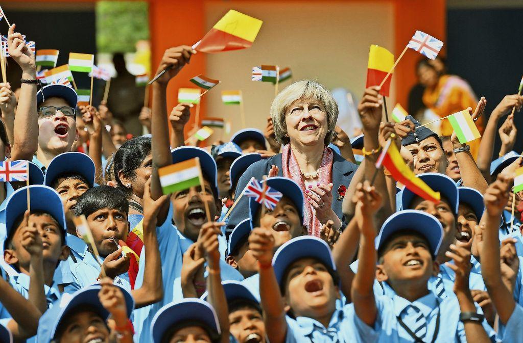Die britische Premierministerin May zu Besuch in Indien. Sie hofft, dass es nach dem Brexit einfacher wird, Verträge mit dem schnell wachsenden Markt zu schließen. Foto: AFP